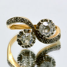 1930s 'You and I' ring with two central diamonds of 0.80 ct and ten small ones