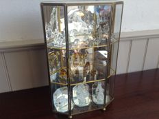 Vintage display cabinet with brass edges and 16 glass miniatures