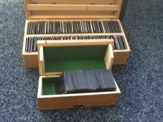 2 boxes with over 125 glass negatives of various European places