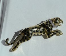18 karat gold vintage panther brooch with 1 ruby and 5 diamonds