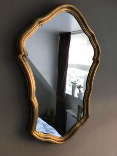 Gorgeous gold-plated brocante mirror.