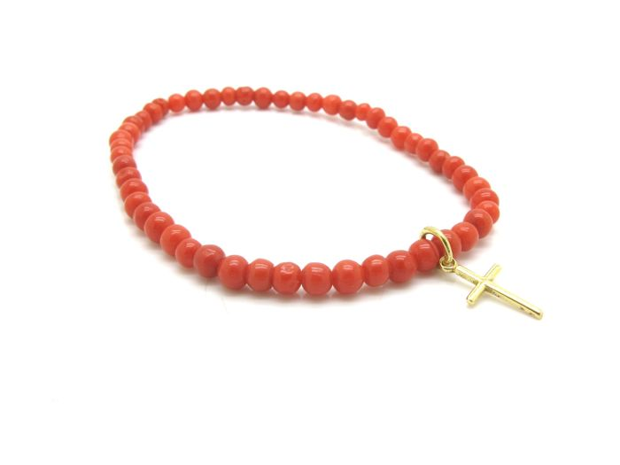 Bracelet made of red Mediterranean coral beads with 18 kt yellow gold cross