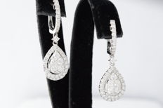 Drop-shaped dangle earrings with brilliant cut diamonds.