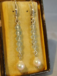 Earrings with tested faceted blue topazes totalling 5.8 ct and white Akoya pearls