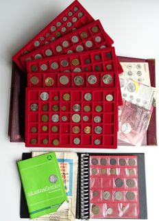 World - lot of coins and medals  in coin case and coin album.