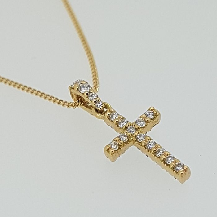 Diamond Cross in red gold with a mix of treated black and white diamonds.