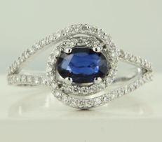 14 kt white gold ring set with a central oval cut sapphire and 70 brilliant cut diamonds, approx. 0.50 carat in total ***NO RESERVE PRICE***