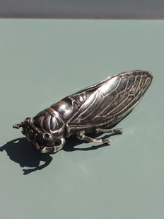 Decorative Art Deco silver Cicade brooch.