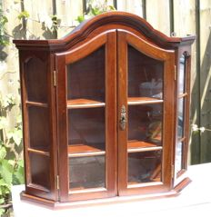 Dark walnut display cabinet with a key