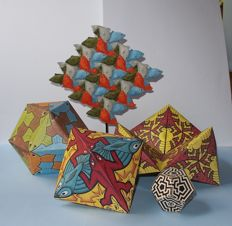 M.C. Escher (Dutch artist and designer) - sculpture with fish, and 4 folding sheets (cardboard)