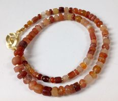 Strand of ancient carnelian and quartz trade beads, ca. 45 cm