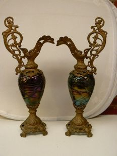 A pair of large decorated ornamental jars in Loetz style
