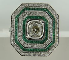 14 kt white gold ring in Art Deco style with 78 carré- and taper-cut emeralds, 60 octagon-cut and one Bolshevik-cut diamond