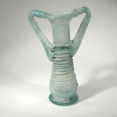 Roman glass balsamarium with two handles and trailing. H 9,3 cm