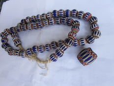 Lot including a big bead and a very old Chevron or rosetta beads necklace
