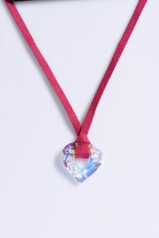 Miss U Heart necklace by Manish Arora. Aurora borealis on a fuchsia ribbon.