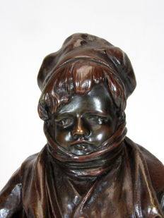 Anton Nelson (1849-1910) - bronze statue of 'wrapped up young man' - Belgium - approx. 1900