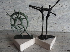 2 beautiful, marked, bronzed sculptures on nature stone pedestals, the theme is connectedness