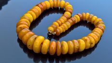 Antique egg yolk Amber necklace.