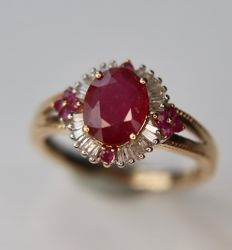 14Kt. Gold cluster ring with a large, oval facet ruby of approx 1.77 ct with baguette cut diamonds and 10 small rubies.