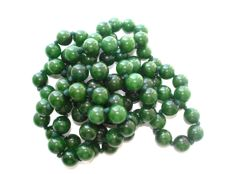 Vintage (1950s) long necklace of genuine Jade / Jadeite beads in dark forest green colour