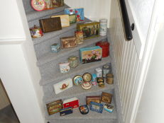 A collection of 36 old packaging cans dating from 1920 to 1970