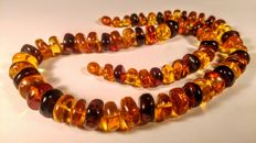 100% Genuine Baltic Amber faceted beads necklace, length 56 cm, 46 grams