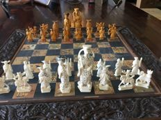 Old Chinese chess set in wooden chest, with bone or ivory chess pieces