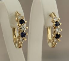 14 kt yellow gold creole earrings set with 4 brilliant cut sapphires, 0.60 carat and 6 brilliant cut diamonds, 0.60 carat, size is 2.0 cm high and 0.5 cm wide.