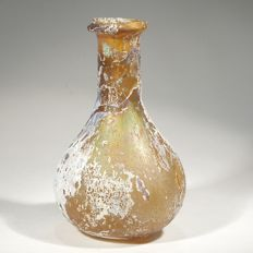 Honey coloured glass flask with white-silver iridescence. H. 8 cm