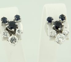 14 kt white gold ear studs, set with brilliant cut sapphire and diamond, size 13 mm x 9 mm.