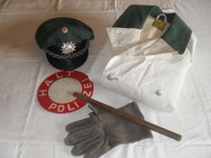 Collection: Traffic police, rain coat, hat, stop signalling sign, gloves, 1950s-60s, used condition