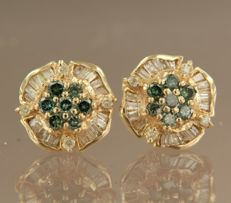 14 kt yellow gold ear studs set with 14 green diamonds 0.72 ct and 44 tapered and brilliant cut diamonds 0.48 ct
