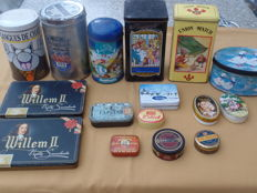 Lot of sixteen tin cans and boxes including four snuff boxes.
