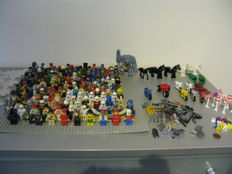 150 mini figures - animals - traffic signs - weapons -shields - mopeds and more.