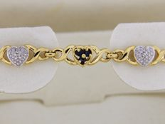 18 kt gold bracelet set with 18 sapphire gemstones and 6 diamonds - Length 19 cm.