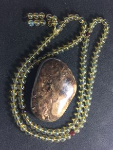 One raw Burma amber and one natural Burma necklace - total: 77.4 gram