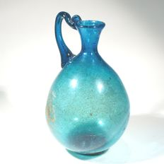 Ancient Islamic glass juglet of an exceptional blue colour.  H. 9.5 cm