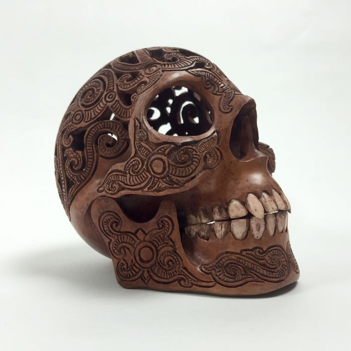 Hand carved human skull tribal style carving teeth