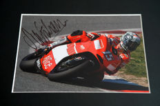 Professionally framed image, personally signed by Sete Gibernau