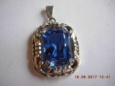 Handmade silver pendants with a blue stone