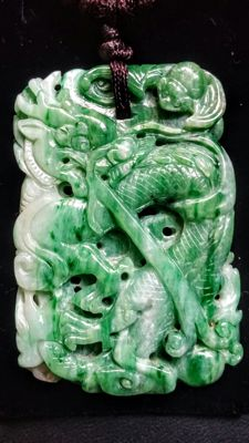 Green vintage Jadeite pendant carved with a dragon/phoenix