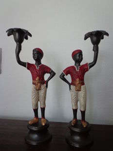A set of metal Blackamoor candlesticks / candle holders