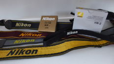 5 original Nikon straps, Nikon Lens Hood HR-2 and Nikon Filter L1 Bc