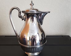 Silver plated water jug engraved with the flag of the White Star Line shipping company