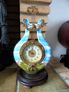 Porcelain pendulum clock, lyre model – first part of the 1900s – France