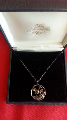 """Franklin mint """"the pendant of wispering love """", 24 krt on sterling silver with 2 faceted rubies"""
