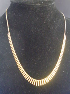 Gold necklace with bars.