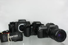 Set of Pentax cameras: Pentax P30T with Pentax-A zoom 28-80mm f 3.5-4.5 objective, the Pentax SF7 and the Pentax Z-70