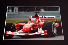 Professionally framed image, personally signed by Rubens Barrichello
